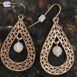 Gold color earrings with dangling pearl